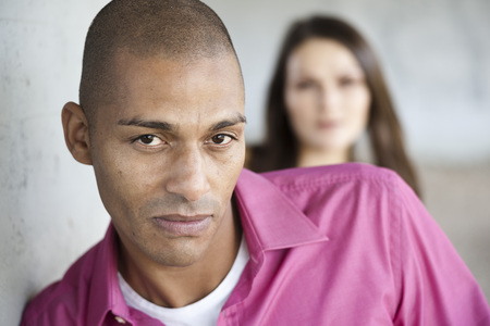 skepticism: Portrait of Man with Woman in Background