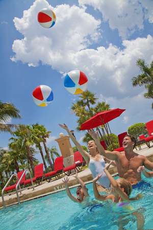 Family in Pool, PGA National Resort and Spa, Palm Beach Gardens, Florida, USA