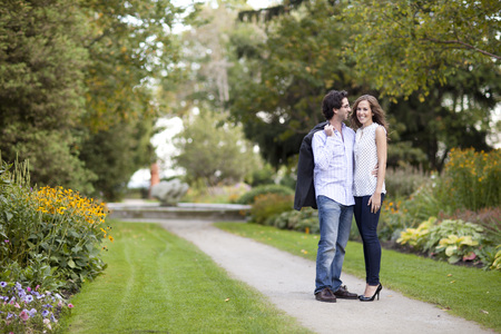 public offering: Portrait of Young Couple Standing on Walkway in Park, Ontario, Canada LANG_EVOIMAGES