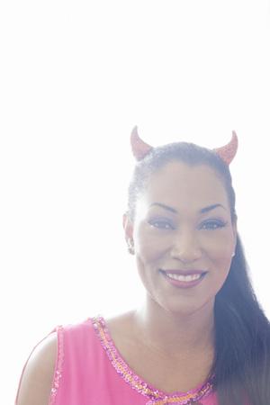 Portrait of Woman Wearing Devil Horns LANG_EVOIMAGES