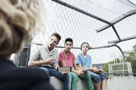 10 15 years: Three Boys and One Girl in Playground,Mannheim,Baden-Wurttemberg,Germany LANG_EVOIMAGES