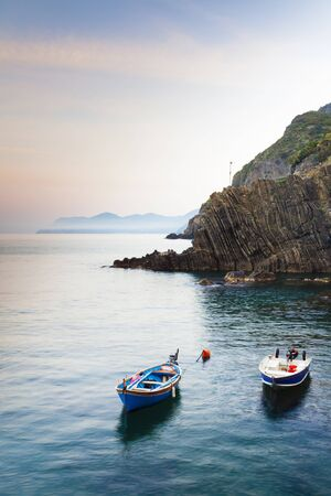 Fishing Boats in little Harbour of Riomaggiore at Dawn,Cinque Terre National Park,UNESCO World Heritage Site,Liguria,Italy