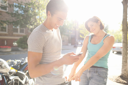 Couple Outdoors,Man using Cell Phone,Portland,Oregon,USA LANG_EVOIMAGES