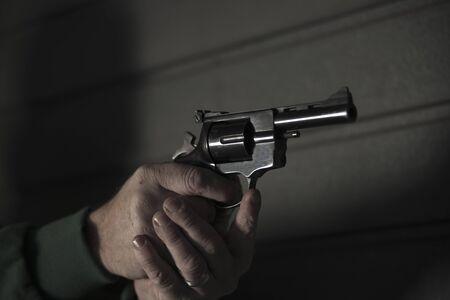 societal: Close-up of Man Aiming Gun,Mannheim,Baden-Wurttemberg,Germany
