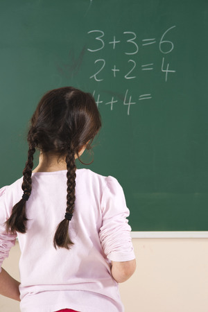 Girl Answering Question at Blackboard in Classroom,Baden-Wurttemberg,Germany LANG_EVOIMAGES