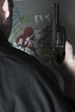 societal: Close-up of Man holding Gun with Graffiti in Background,Mannheim,Baden-Wurttemberg,Germany