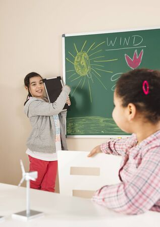 explained: Girls Learning about Alternative Energy in Classroom,Baden-Wurttemberg,Germany