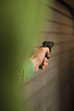 societal: Close-up of Young Man Aiming Handgun,Mannheim,Baden-Wurttemberg,Germany