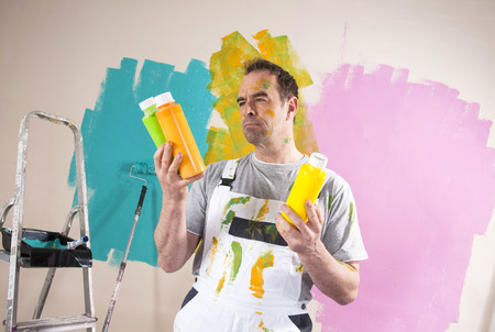 yellowish green: Mature Man Renovating his Home and Deciding between Paint Colors LANG_EVOIMAGES