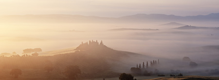 podere: Typical Tuscany landscape in morning with fog,in foreground is Podere Belvedere a farm near San Quirico dOrcia. Val dOrcia,Orcia Valley,Siena district,Tuscany,Toscana,Italy