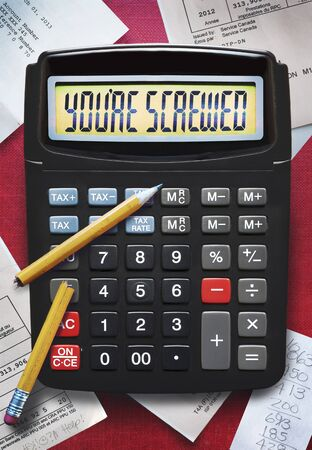 view of calculator with broken pencil and tax forms