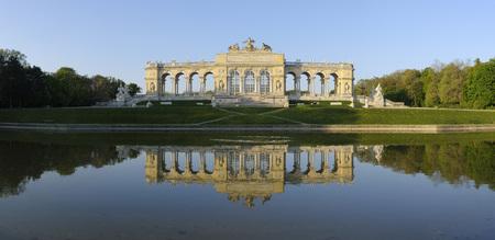gloriette: Gloriette reflected in Pond in Garden at Schonbrunn Palace,Vienna,Austria LANG_EVOIMAGES