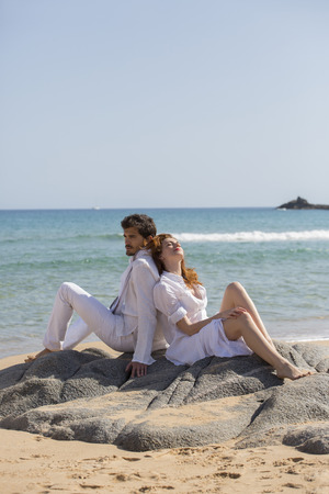 leaned: Couple Leaning against each other at Beach,Sardinia,Italy
