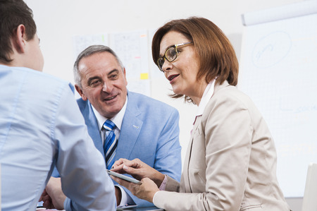 conferring: Business People in Office, Mannheim, Baden-Wurttemberg, Germany
