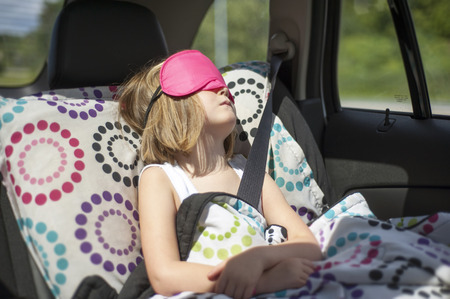 leaned: Young girl sleeping in car during a family roadtrip,Quebec,Canada LANG_EVOIMAGES