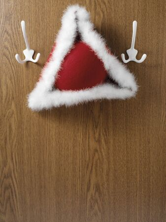 tricorne: Tricorne hat hanging on hook, studio shot