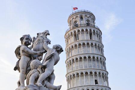 Cherub Statue of Fontana Dei Putti with Leaning Tower of Pisa, Piazza dei Miracoli, Pisa, Tuscany, Italy