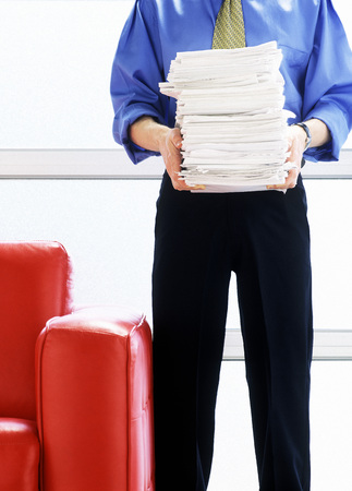 Man holding a Stack of Papers