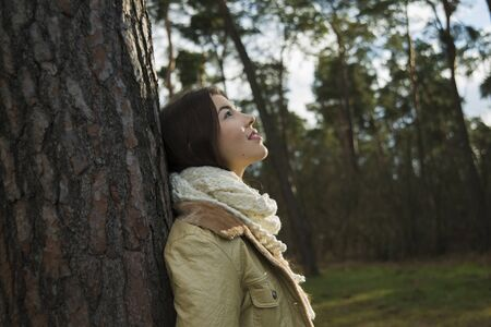 leaned: Young Woman Leaning against Tree Trunk, Mannheim, Baden-Wurttemberg, Germany LANG_EVOIMAGES