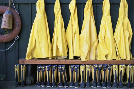 Row of Raincoats and Rubber Boots Tofino, British Columbia, Canada