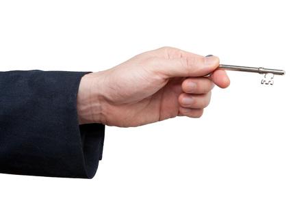 real estate sold: Close-up of mans hand holding skeleton key, studio shot on white background LANG_EVOIMAGES