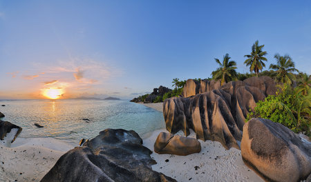 Rock Formations and Palm Trees at Sunset, Anse Source d´Argent, La Digue, Seychelles