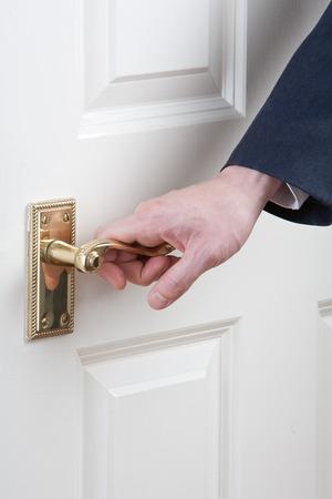 achievment: Close-up of Mans hand on door handle, studio shot