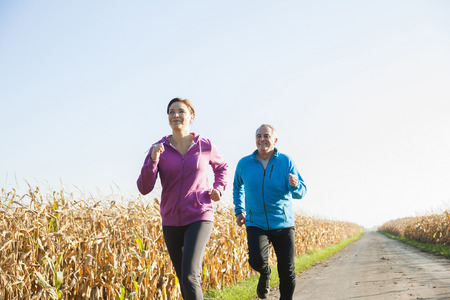 Couple Jogging Outdoors, Baden-Wurttemberg, Germany LANG_EVOIMAGES