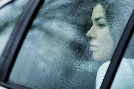 Young Woman in Car on Rainy Day, Mannheim, Baden-Wurttemberg, Germany LANG_EVOIMAGES
