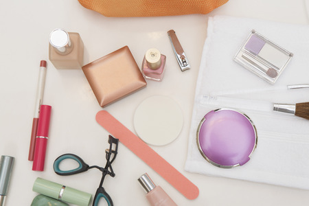 Overhead View of Bathroom Countertop with Womens Cosmetics and Beauty Products LANG_EVOIMAGES