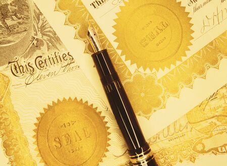 Close-Up of Pen and Certificates    LANG_EVOIMAGES