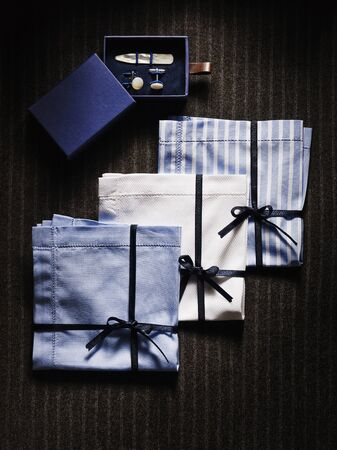 hanky: Overhead View of Box with Collar Stays and Cuff Links with Three Handkerchiefs