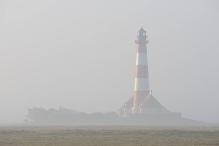 westerheversand: Westerheversand Lighthouse in Fog, Eiderstedt Peninsula, Westerhever, Germany