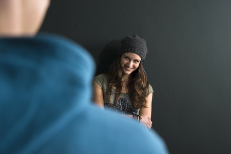 leaned: Teenage Girl and Young Man Talking, Studio Shot