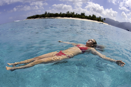 dyke: Woman floating in the Caribbean Sea at Little Jost Van Dyke in the British Virgin Islands, Caribbean
