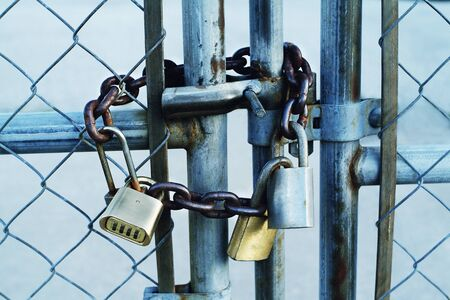 Padlocks and Chain on Fence Gate    LANG_EVOIMAGES