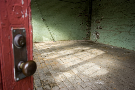 A room with a cobblestone floor in an abandoned building in Newport, Rhode Island, USA LANG_EVOIMAGES