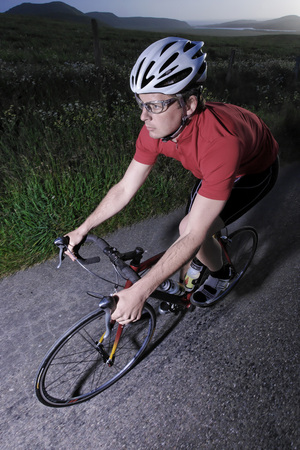 road cycling: Male triathelete on bicycle training and cycling near Point Reyes, California, USA LANG_EVOIMAGES