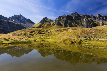 Mountains of Pizol Range Reflected in Pond in Autumn, Glarus Alps, Canton of St Gallen, Switzerland LANG_EVOIMAGES