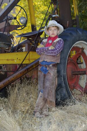 leaned: Portrait of Young Cowboy, Shell, Wyoming, USA LANG_EVOIMAGES