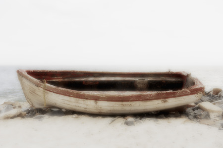 Wooden boat on beach in foggy weather, South Africa