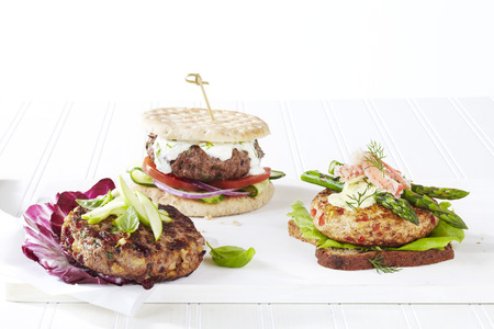 multi grain sandwich: Three healthy hamburger options with different toppings, studio shot on white background