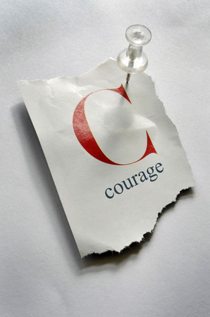 Close-up of Torn Page with C and Courage on it, Pinned to Board LANG_EVOIMAGES