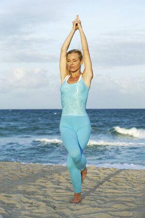 spandex: Woman Doing Yoga on Beach