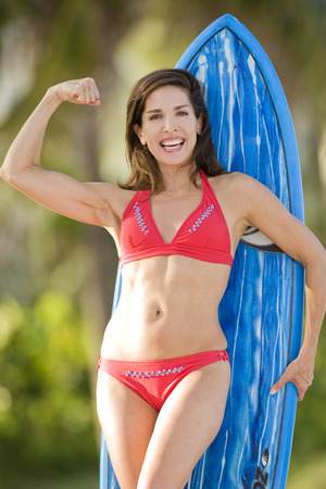 flexing: Portrait of Surfer, Fort Lauderdale Beach, For Lauderdale, Florida, USA