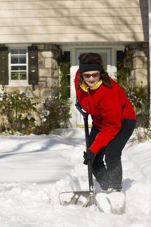 Woman Shovelling Walkway