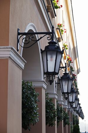 lamp shade: Close-up of a row of lanterns on buildings, Old Town, Warsaw, Poland LANG_EVOIMAGES