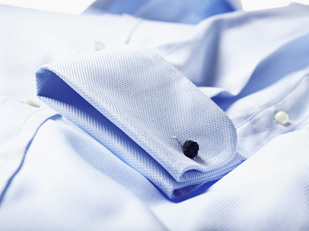 Detail of cuff of blue shirt in studio LANG_EVOIMAGES
