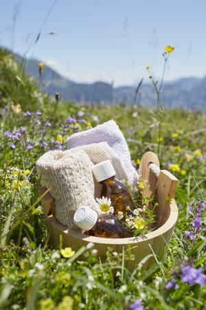 holistic view: Bucket with Homeopathic Medicine in Flower Field, Strobl, Salzburger Land, Austria
