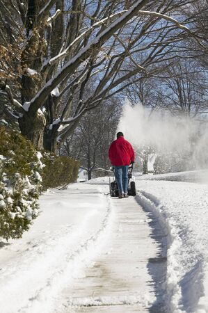 Man Using Snowblower LANG_EVOIMAGES